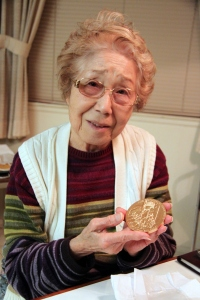 Holding Uncle Paul's Congressional Gold Medal for the first time, Aunt Eiko cried for happy.  Incidentally, she became an American citizen about ten years ago.