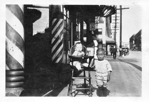 Uncle Suetaro is on the high with Dad standing next to him.  They are in front of my grandparent's barber on King St and Maynard in Seattle.  Circa 1921.  The shop was inside Hotel Fujii (no longer standing).