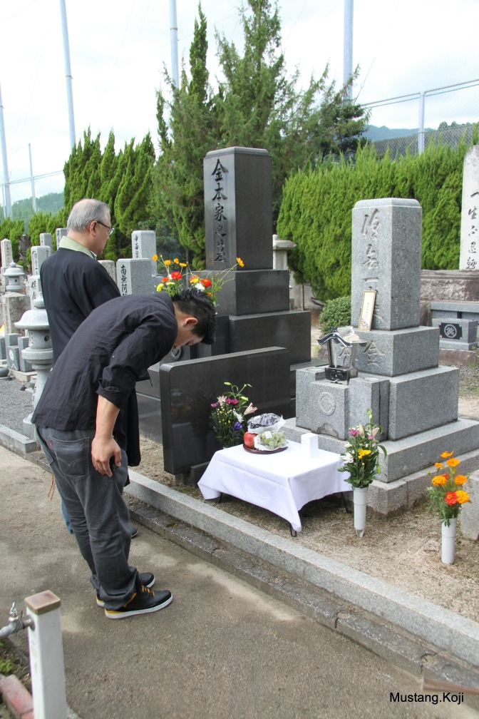 My 24 year old son Takeshi bowing at the family crypt which contains the ashes of Uncle Suetaro who was killed at the same age of 24.