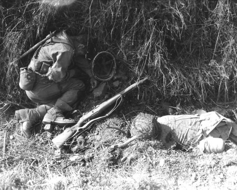 Two from the US Army 3rd Armored killed in action in France. National Archives.