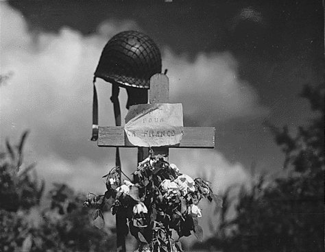 French civilians erected this silent tribute to an American solider who has fallen in the crusade to liberate France. Carentan, France., 06/17/1944