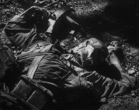 "Dead Japanese soldier in advanced decomposition.  Perhaps this is what Old Man Jack tried to suppress in his recollection of ""ID patrol""."
