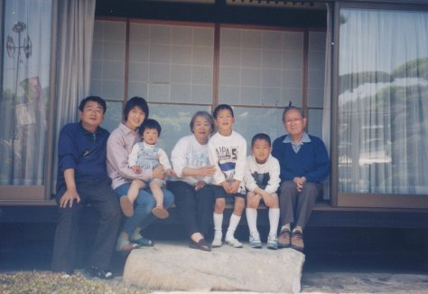 My dad (R) returned to Hiroshima for a vacation in 1997; Masako is in the center. This was taken at his family home. Notice the stepping stone; it is the same one Masako stood next to in a picture taken in 1948.